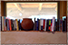 Photo of books on a window shelf, looking out to the sunny front portal
